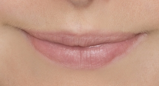 Undefined lips are coloured with natural pigments.